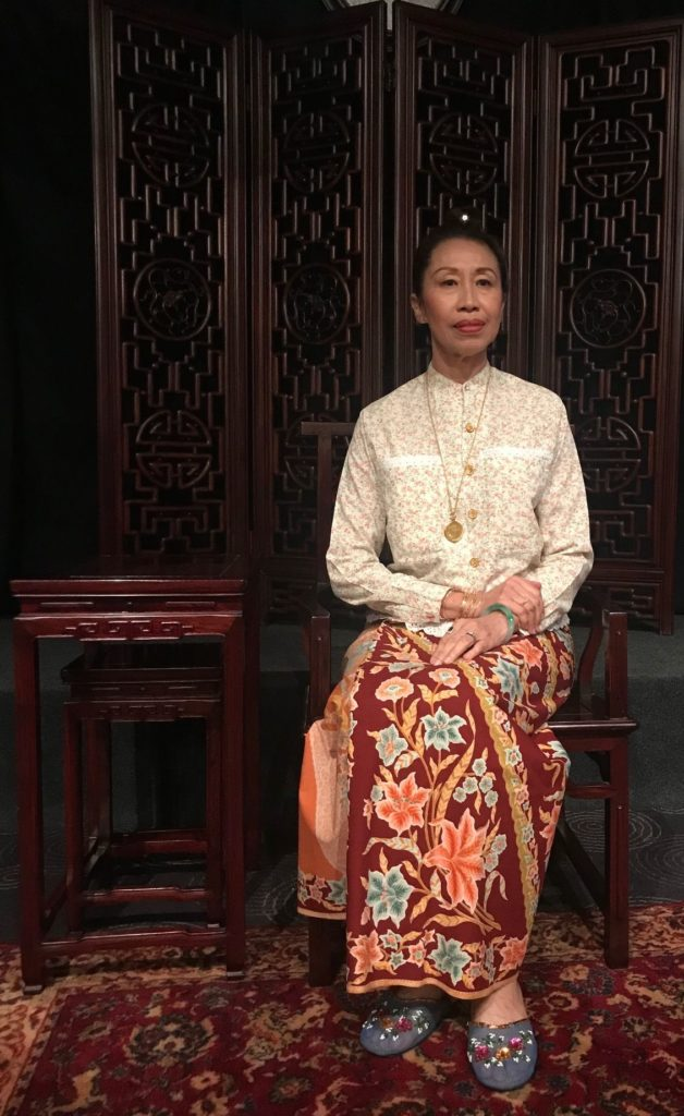 Lady in Peranakan costume