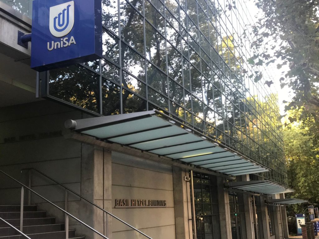 UniSA logo, concrete and glass frontage and stairs